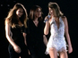 Swift joined by Cara Delevingne on stage