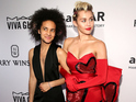 The singer dazzled in a red gown as she arrived at the amfAR gala with date Tyler Ford.