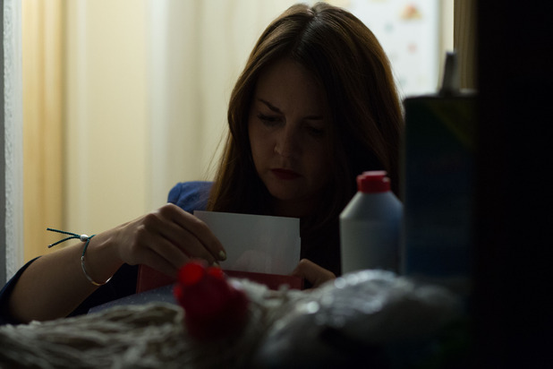 Stacey searches through Jean's things looking for clues.