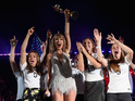 The singer held the FIFA Women's World Cup trophy aloft during a show in New Jersey.