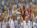 The United States Women's National Team celebrates with the trophy after they beat Japan 5-2 in the FIFA Women's World Cup soccer championship in Vancouver