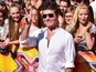 Simon Cowell gets an X Factor snog