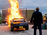 Robert watches as his car goes up in flames