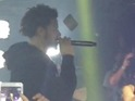 An unimpressed fan or an overexcited one: either way, J Cole got a new phone out of it.