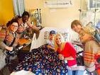 New Ghostbusters cast visit a children's hospital in costume and pose for adorable photos