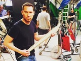 Bryan Singer shows off a piece of Archangel's wings on the X-Men: Apocalypse set