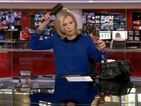 BBC News presenter caught styling her hair live on air - but brushes it off like a pro
