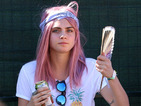 Cara Delevingne shows off bubblegum pink hairdo at music festival as she supports St. Vincent