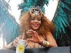 Rihanna strips to an eye-popping carnival costume and parties with Lewis Hamilton in Barbados