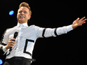 Fans can hear snippets of the track by pressing on Olly's musical lips.