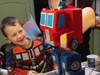 This video of a kid's transforming Optimus Prime birthday cake is pure joy