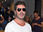 Simon Cowell apologises for his angry outburst after getting the Overs category
