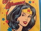A little girl's Wonder Woman lunchbox has been declared 'too violent' for school