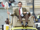 Rowan Atkinson celebrates 25 years of Mr Bean by recreating classic car scene at Buckingham Palace