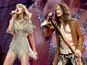 Taylor Swift performs with Steven Tyler