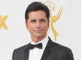 John Stamos arrives at the 67th Annual Primetime Emmy Awards at Microsoft Theater